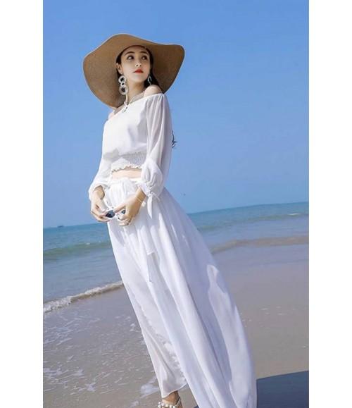 Set áo trễ vai tay dài kết hợp chân váy trắng dây nơ